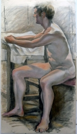seated male model facing left aarms on table (590x1024)