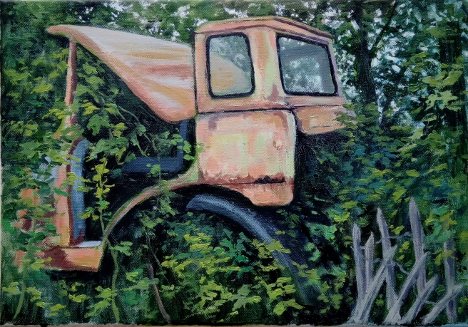tractor in a hedge